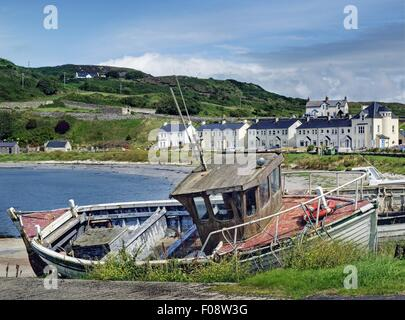 View of fishing boat at coast, mountains and building in Rathlin Island, Ireland - Stock Photo