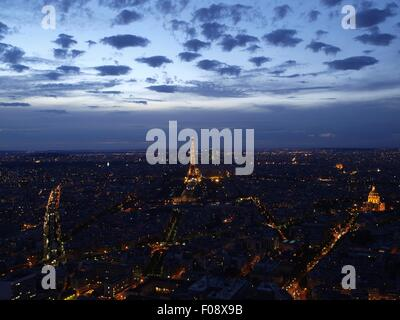 Illuminated cityscape at night from Tour Montparnasse in Paris, France - Stock Photo