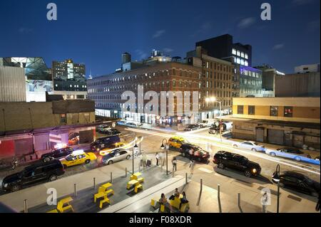 Busy streets with buildings at night from Standard Hotel, High Line, New York, USA - Stock Photo