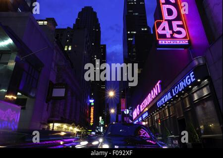 Neon signboards at Times Square at night, New York, USA - Stock Photo