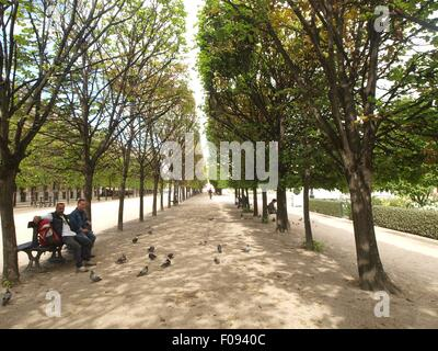 People sitting in garden of Palais-Royal, Paris, France - Stock Photo
