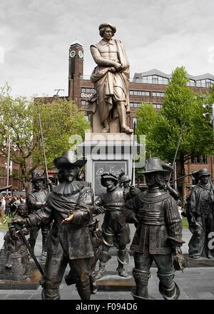 Statue of Rembrandt van Reijn in Rembrandtsplein (Rembrandt Square), Amsterdam and figures from 'De Nachtwacht' - Stock Photo