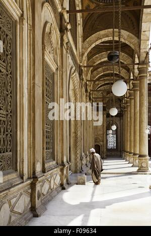Man at courtyard of Muhammad Ali Mosque, Cairo, Egypt - Stock Photo