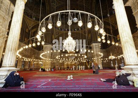 People in Muhammad Ali Mosque dome room, Cairo, Egypt - Stock Photo