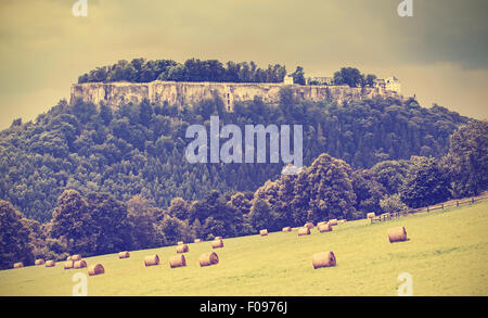 Retro toned landscape with fortress Koenigstein before rain, Germany. - Stock Photo