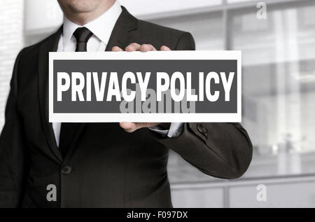 Privacy Policy sign is held by businessman. - Stock Photo