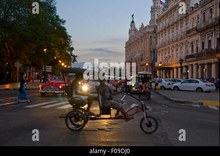 Horizontal street view of a bicyclette at dusk in Havana, Cuba. - Stock Photo