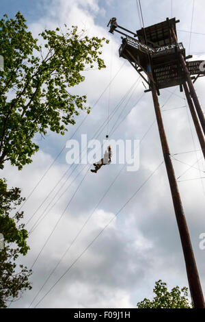 100 foot drop during zipline adventure at Branson Zipline Canopy Tours in Branson, MO. - Stock Photo