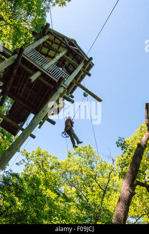 45 foot drop during zipline adventure at Branson Zipline Canopy Tours in Branson, MO. - Stock Photo