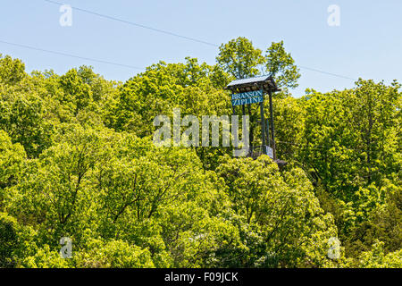 Zipline adventure at Branson Zipline Canopy Tours in Branson, MO. - Stock Photo