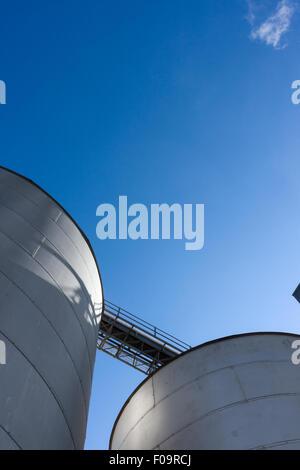 Silos set against a blue sky. - Stock Photo