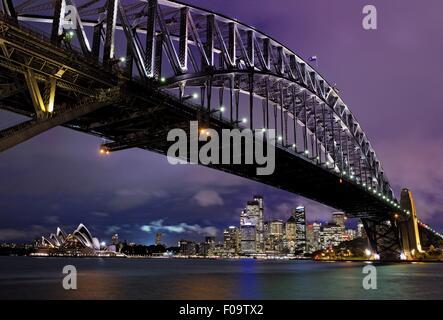 Sydney Harbour Bridge overlooking Opera House in New South Wales, Australia - Stock Photo