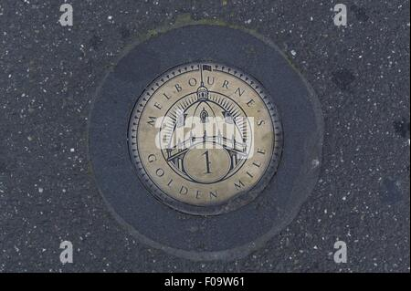 Close-up of Golden Mile plaque on ground in Melbourne, Victoria, Australia - Stock Photo