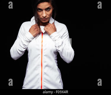 Portrait of fitness woman in sports clothing looking at camera with an attitude. Caucasian female model in sportswear - Stock Photo