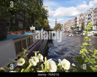View of houses and Prinsengracht canal in Amsterdam, Netherlands - Stock Photo