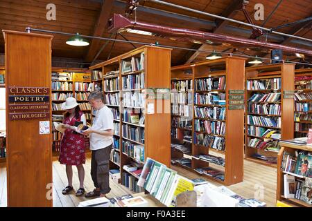 Locals in Richard Booth's Bookshop in Hay-on-Wye, Hereford, Wales, UK - Stock Photo