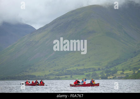 A group of people in canoe boats on Wastwater in the Lake District, Cumbria, UK - Stock Photo