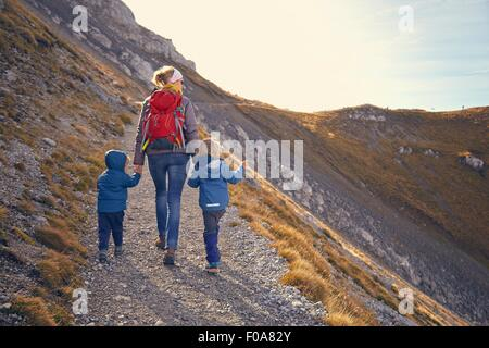 Mother and sons, hiking along mountain path, Karwendel-Mittenwald, Bavaria, Germany - Stock Photo