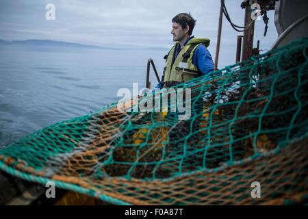 Fisherman preparing net, Isle of Skye, Scotland - Stock Photo