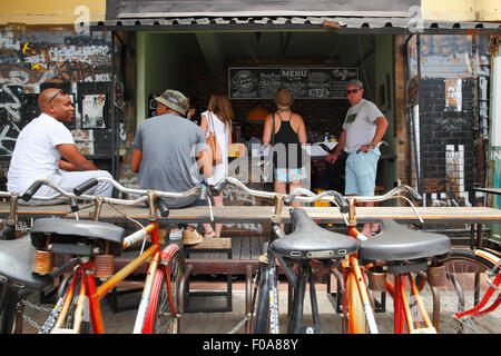 South Africa, Johannesburg, Maboneng Precinct. Bicycles for hire outside Arts on Main. - Stock Photo