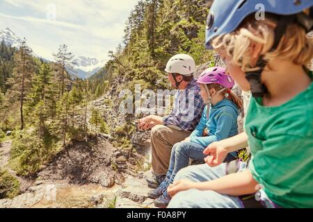 Father and children enjoying view on hill, Ehrwald, Tyrol, Austria - Stock Photo