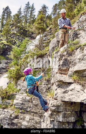 Father and child rock climbing, Ehrwald, Tyrol, Austria - Stock Photo