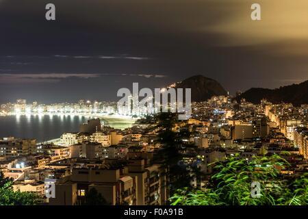 Elevated view of Copacabana and Leme from Morro da Babilonia at night, Rio de Janeiro, Brazil - Stock Photo