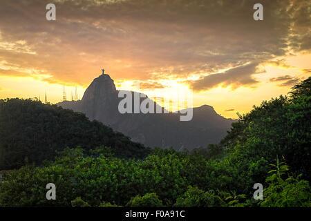 View of Christ the Redeemer statue from Morro da Babilonia at dusk, Rio de Janeiro, Brazil - Stock Photo