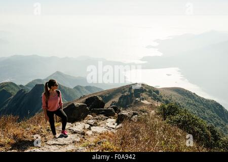 Young woman hiker on Lantau Peak looking away, Lantau Island, Hong Kong, China - Stock Photo