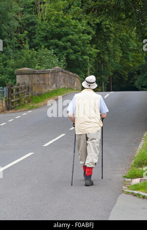 Walking in the road over the bridge at Stafford, Staffordshire in August - Stock Photo