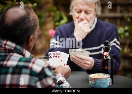 Two senior men playing cards - Stock Photo