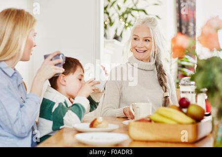 Three generation family having breakfast - Stock Photo
