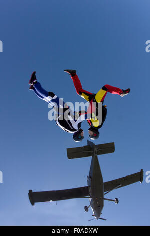 Freeflying skydivers in blue sky - Stock Photo