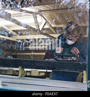 Man working in ski making workshop - Stock Photo