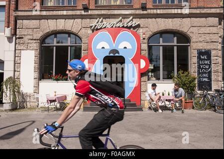 Man on bike in front of Honolulu Bar in Beirut, Lebanon - Stock Photo