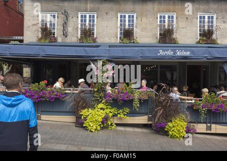 People sitting outside Restaurant Jardin Nelson on Place Jacques-Cartier, Montreal, Canada - Stock Photo