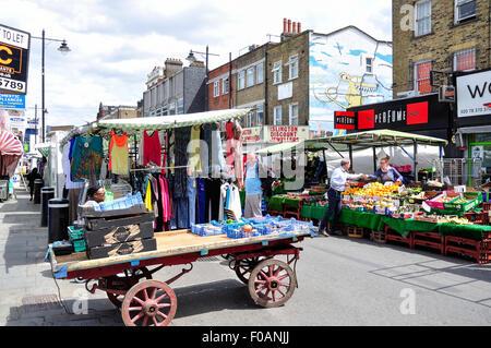 Clothing and food stalls in Chapel Market, Islington, London Borough of Islington, London, England, United Kingdom - Stock Photo