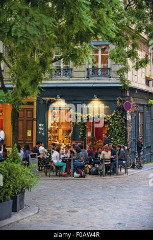 People sitting in Sidewalk in front of cafe, Lyon, France - Stock Photo
