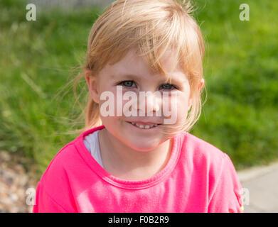 Portrait of 3 year old blonde girl, Daventry, Northamptonshire, England, United Kingdom - Stock Photo