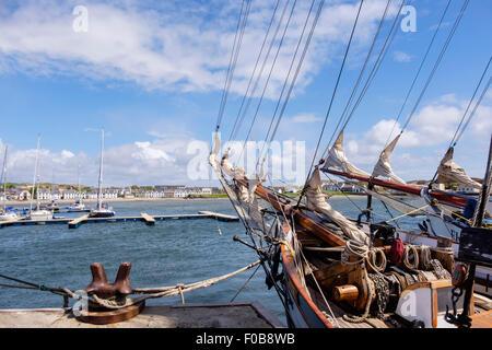 Sailing ships tied to quay in Leodamais Bay harbour. Port Ellen (Ilein) Isle of Islay Inner Hebrides Western Isles - Stock Photo