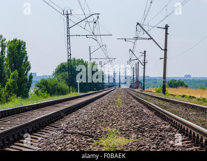 rails stretching into the distance on the bridge - Stock Photo