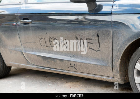 Clean Me! hand written on dirty car England UK europe - Stock Photo