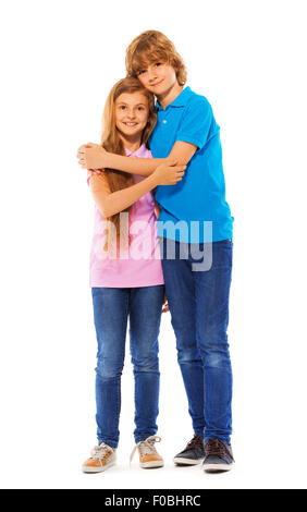 Two siblings boy and girl on white portrait - Stock Photo