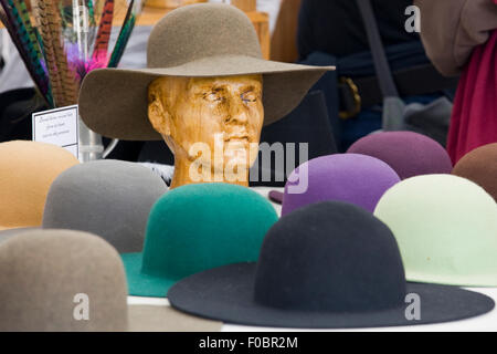 Vintage wool hats on a market stall - Stock Photo