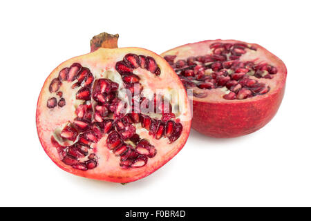 Close-up of a ripe red pomegranate cut in half, isolated on white background. - Stock Photo
