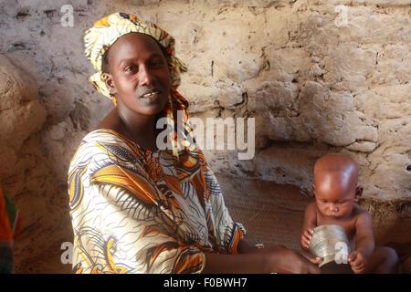BANDIAGARA, MALI - SEPTEMBER 28, 2008: Unidentified woman with her baby in bandiagara in the Mopti region in Mali - Stock Photo