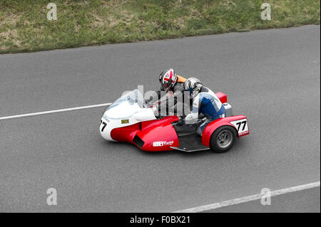 Steve Brooks on no77 sidecar at the 2015 Southern 100 races - Stock Photo