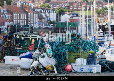 Lobster and crab baskets on the jetty in Whitby north Yorkshire - Stock Photo