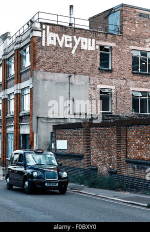 I love you, sign on wall, London - Stock Photo