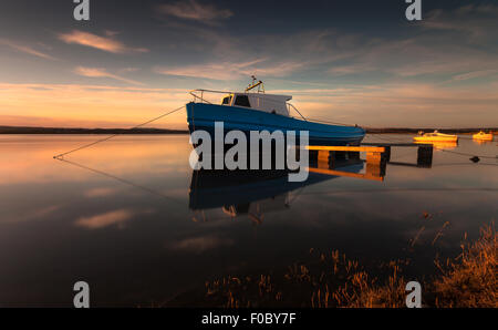 Fishing boat moored on the Loughor Estuary, Penclawdd, north Gower, Swansea. - Stock Photo